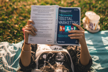 reading a book about digital marketing