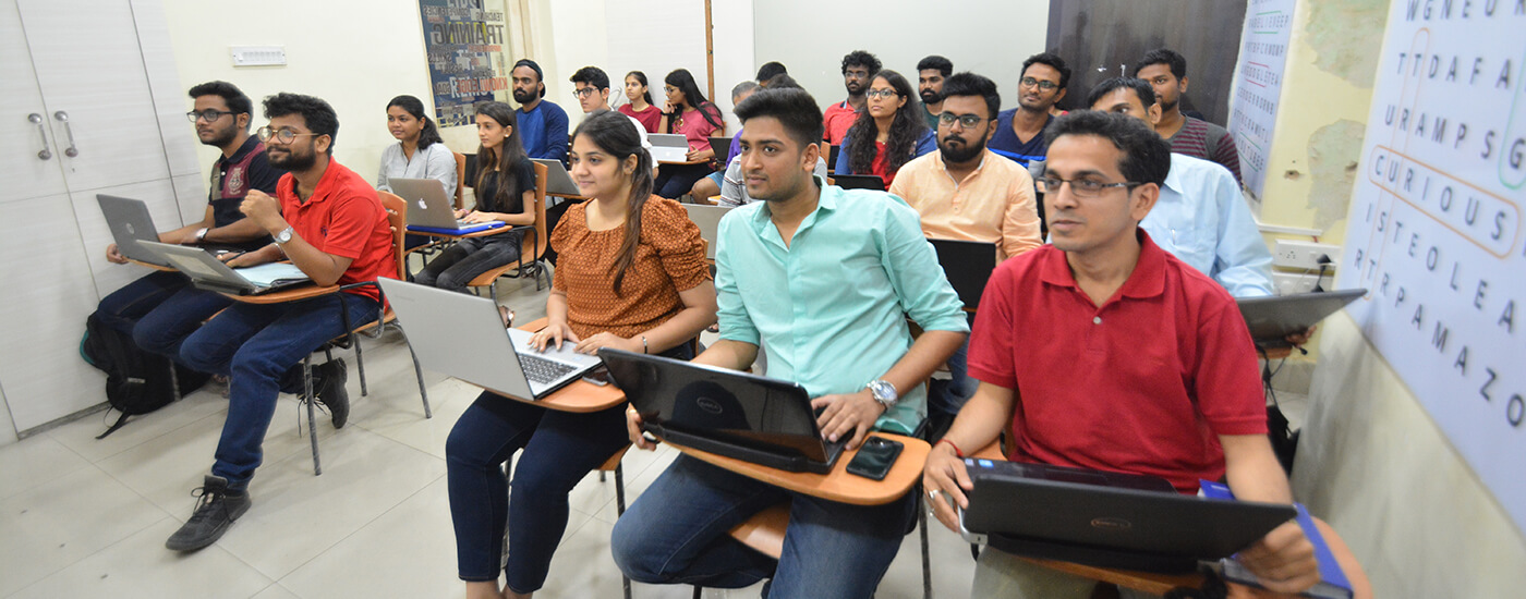 Students of Niht attending digital marketing class with laptops